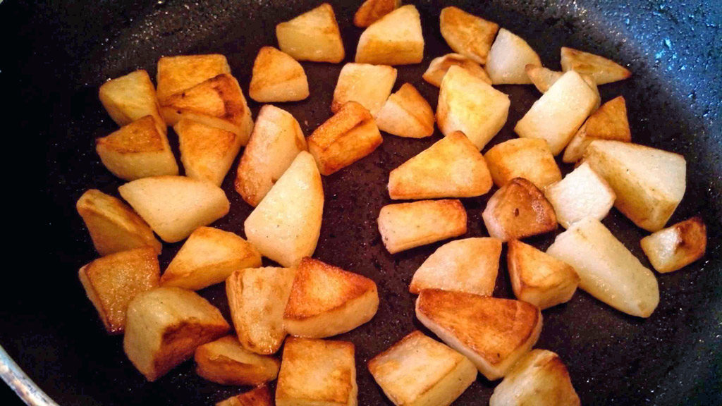 browned potatoes in skillet