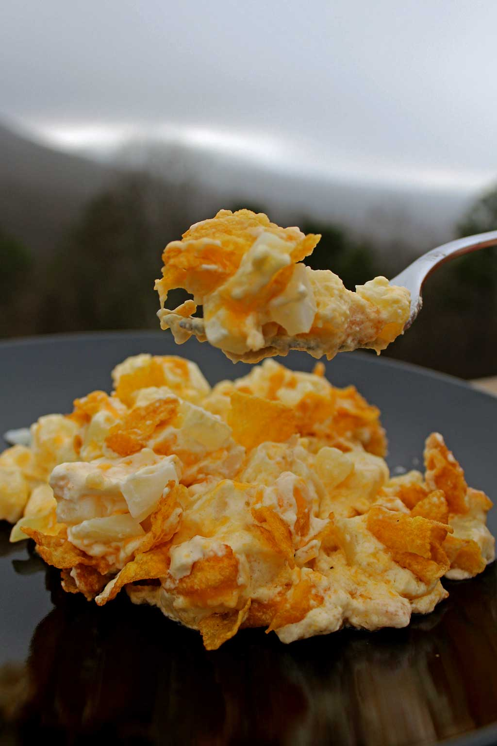 Hash Brown Potato Casserole: hash brown potatoes and onions, mixed in a creamy sour cream and cheese mixture, baked and topped with buttery corn flakes.