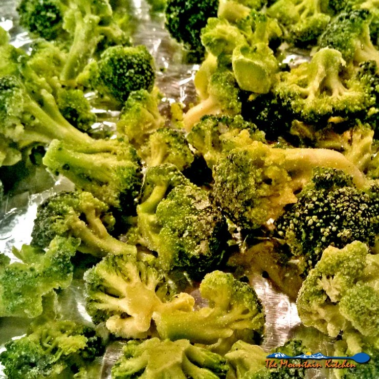 This delicious roasted broccoli is drizzled with olive oil, salt and pepper and then sprinkled with fresh grated parmesan cheese, oven roasted until tender. | TheMountainKitchen.com