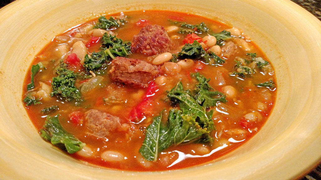 Spanish-Style White Bean, Kale & Chorizo Soup is gutsy, flavorful, and so good! Made with white beans, peppers, chorizo, and kale in a rich saffron broth. | TheMountainKitchen.com