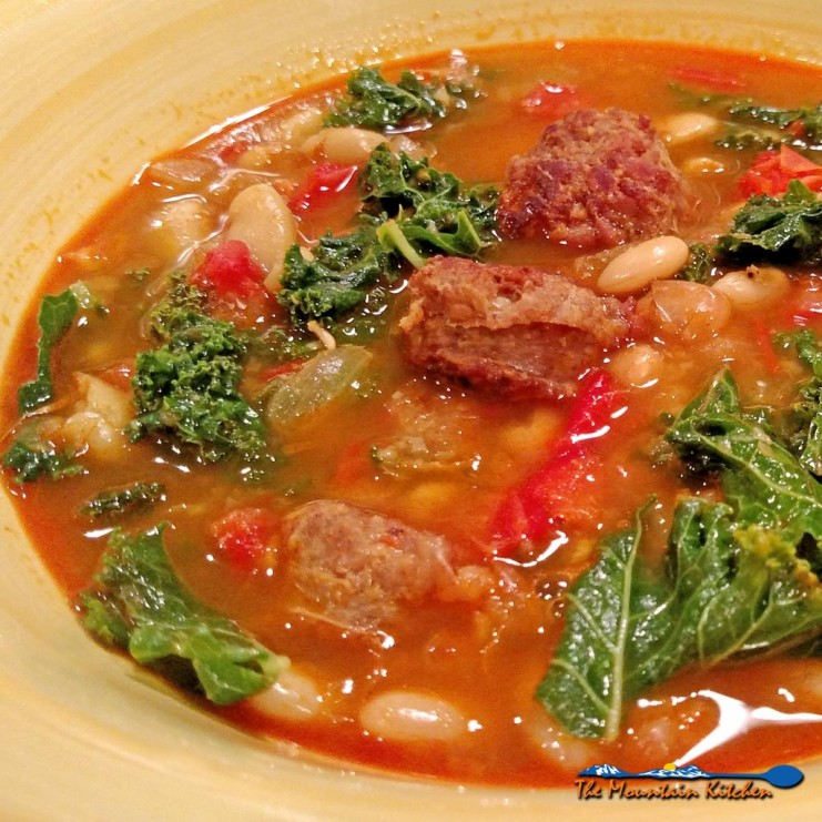 Spanish-Style White Bean Soup With Kale and Chorizo is gutsy, flavorful, and so good! Made with white beans, peppers, chorizo, and kale in a saffron broth. | TheMountainKitchen.com