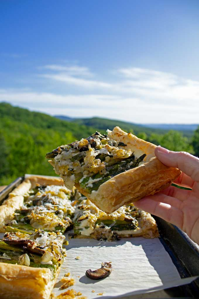 With each bite of this asparagus-ricotta tart, you get a taste of lemony ricotta cheese, crisp puff pastry, and sweet pops of garlicky onions and mushrooms.