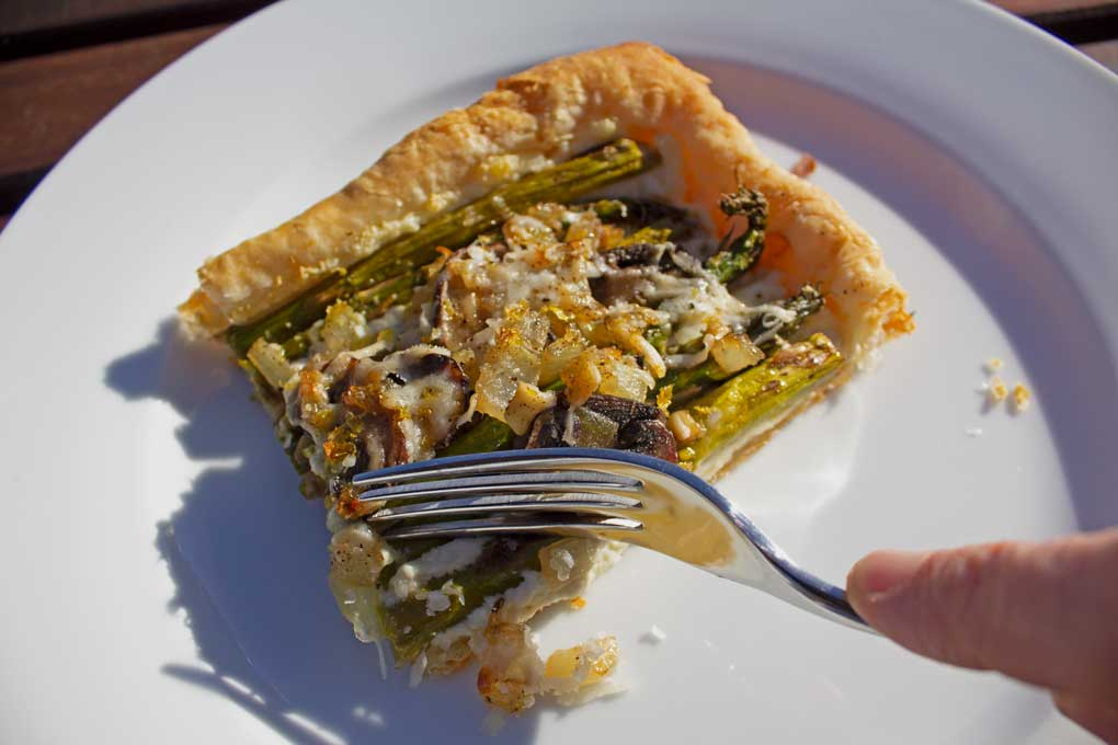 sticking fork into a slice of tart