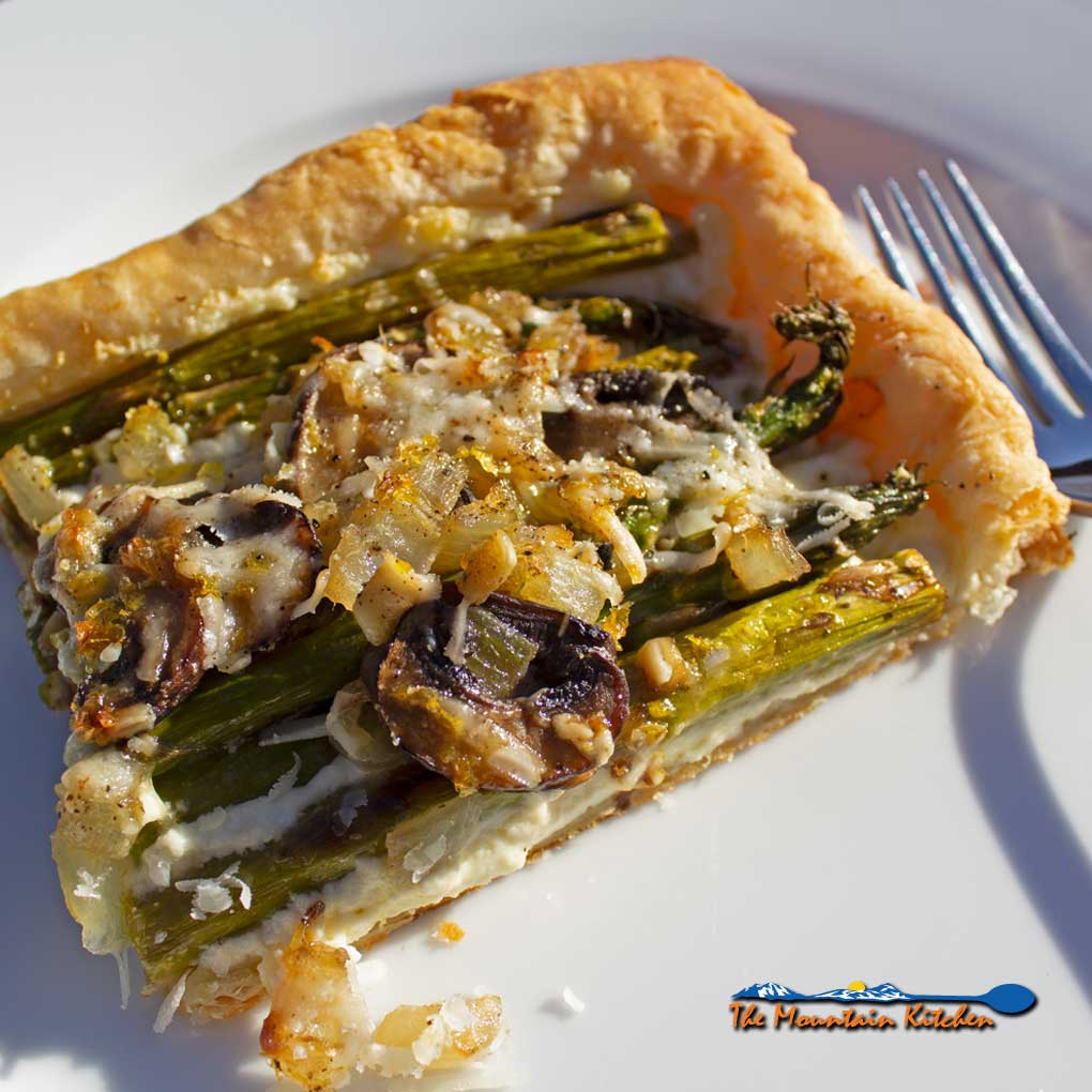 asparagus ricotta tart on plate ready to eat