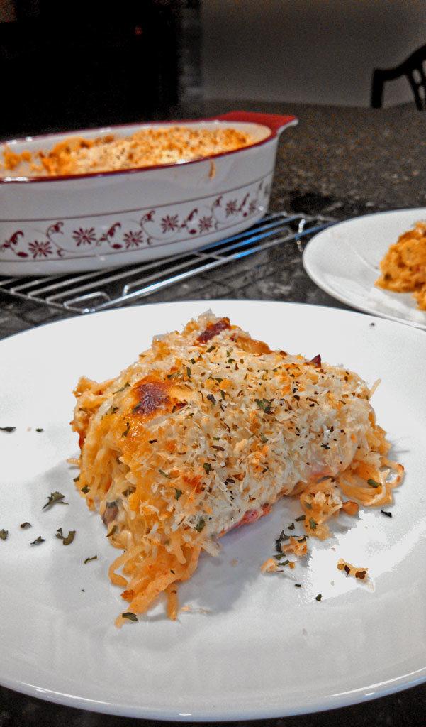 Spaghetti Squash Casserole is a healthy and comforting way to prepare spaghetti squash mixed with mushrooms, tomatoes, onion, ricotta and mozzarella cheese.