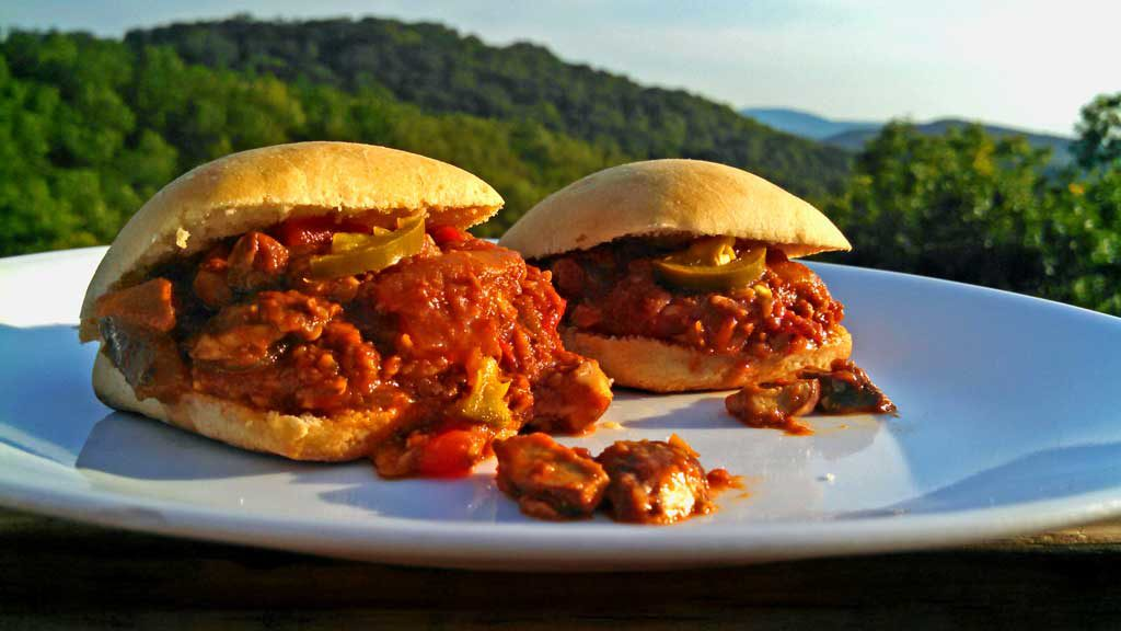 Spicy Sloppy Mushroom Sliders are a healthy vegetarian version of classic Sloppy Joes. Quick, and easy to make and just as good. You'll never miss the meat!   TheMountainKitchen.com