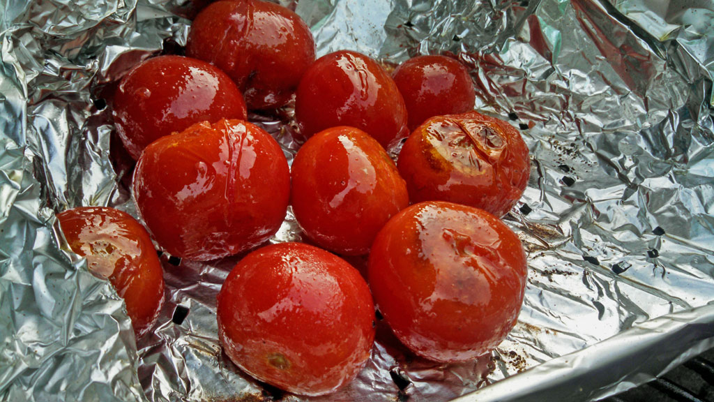 Instead of buying a grilling basket use aluminum foil. Shape the foil into the shape of a box, place on the grill, and poke holes in it. An inexpensive fix!   TheMountainKitchen.com
