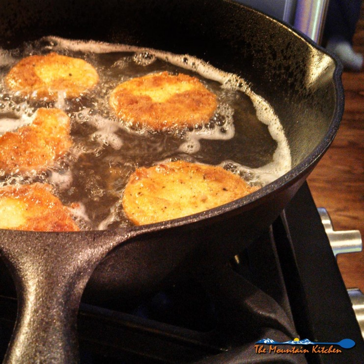 fried green tomatoes in cast iron pan