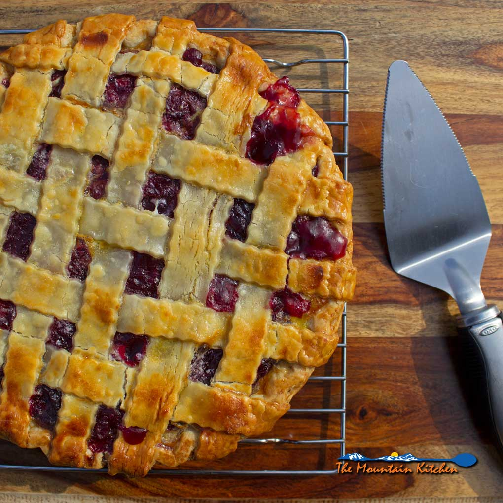 homemade cherry pie ready to slice