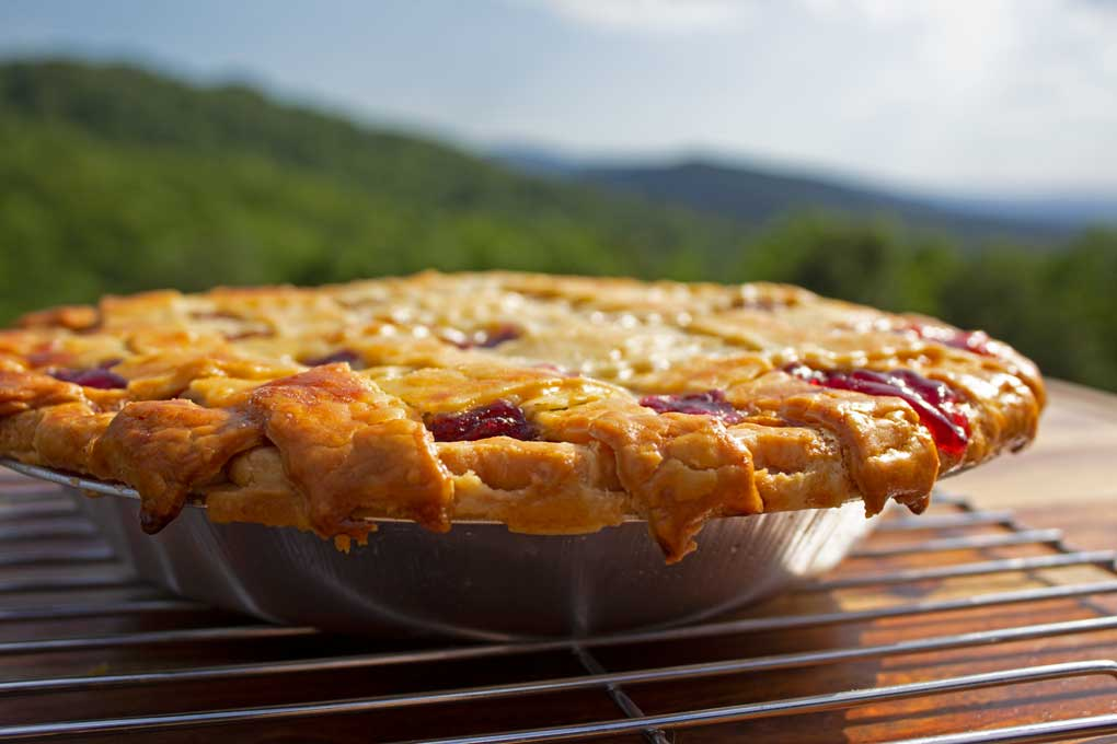 homemade cherry pie with mountain view
