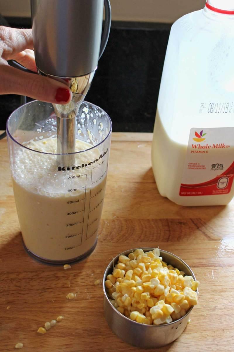 immersion blender blending milk and corn