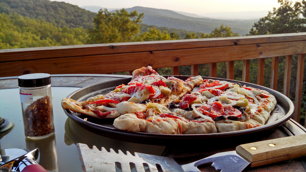 Grilled veggie pizza with mountain view