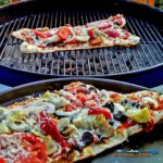 Grilled veggie pizzas on charcoal grill