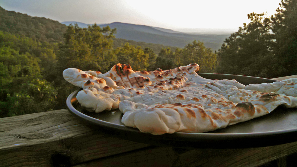 grilled pizza crust with mountain view