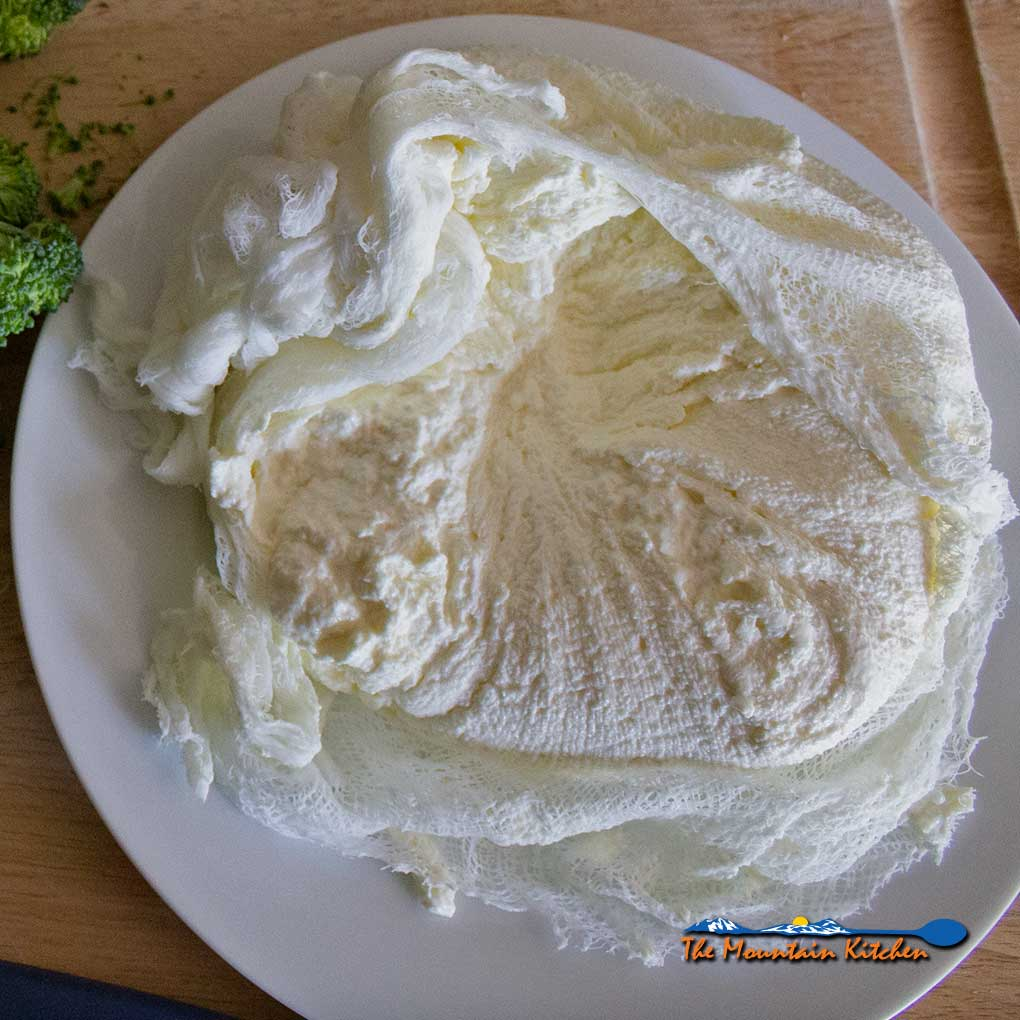 homemade ricotta cheese in cheesecloth