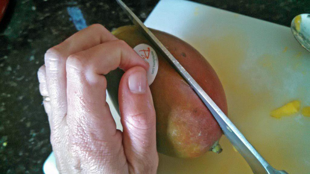 slicing knife into mango