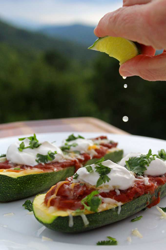 Meatless Mexican Zucchini Boats are stuffed with refried beans mixed with onions, Mexican seasonings, salsa, and cheese. A yummy Meatless Monday meal!