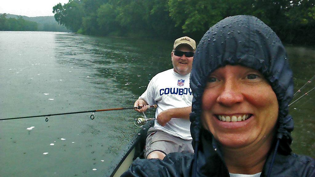 David and Debbie in the canoe in the rain