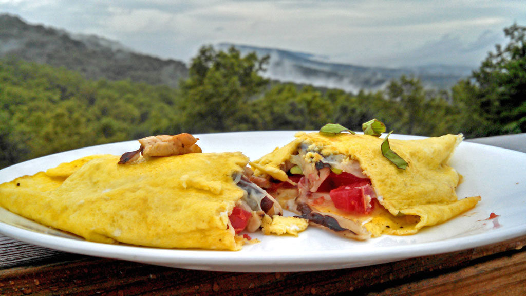 mushroom tomato basil omelet with mountain view