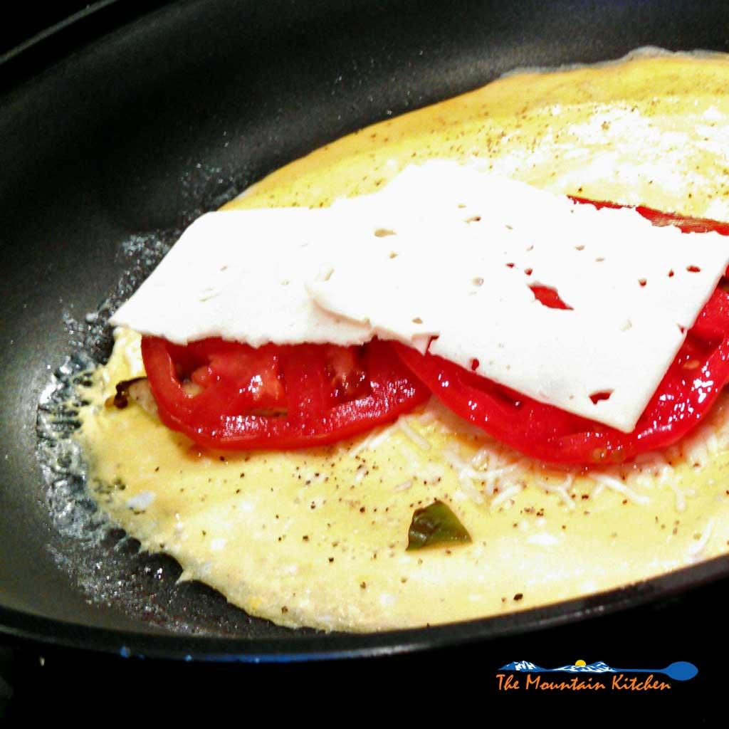 These mushroom tomato basil omelets are simple to make using fresh ripe tomatoes, shiitake mushrooms, garden fresh basil and creamy mozzarella cheese. YUM!
