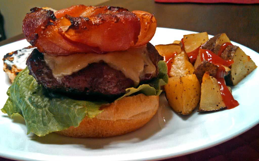 Bacon Onion Burger Crowns ~ Slices of crispy, smokey bacon wrapped around sweet onion rings grilled or baked to make the perfect crown for your next burger. | TheMountainKitchen.com