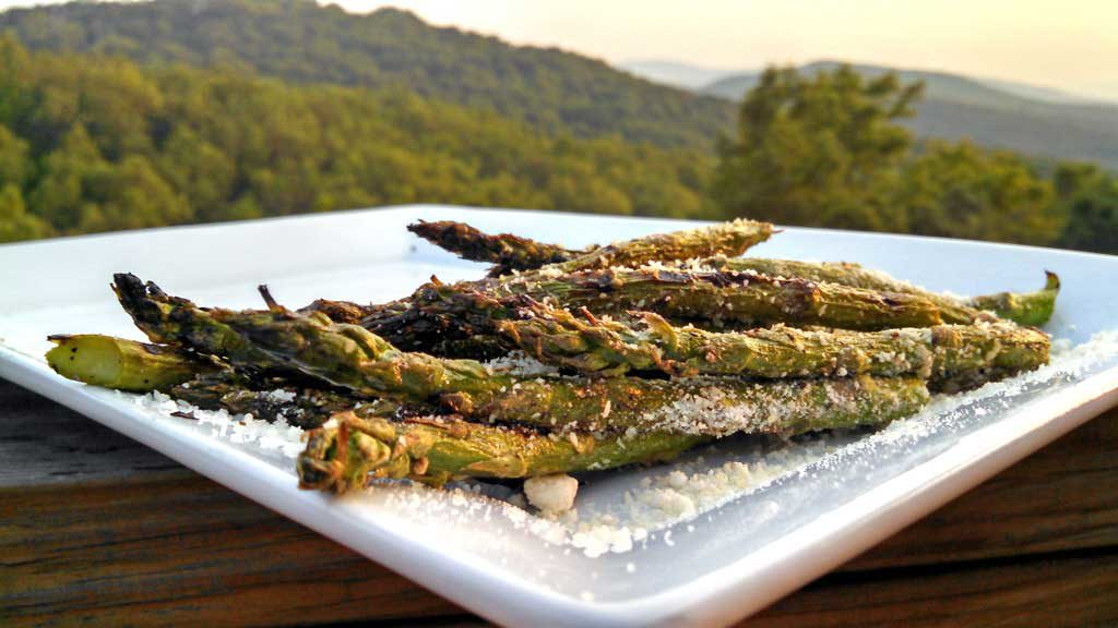 These grilled asparagus are seasoned with salt & pepper, olive oil and lemon zest. Grilled until slightly charred and tender, topped with Parmesan cheese. | TheMountainKitchen.com