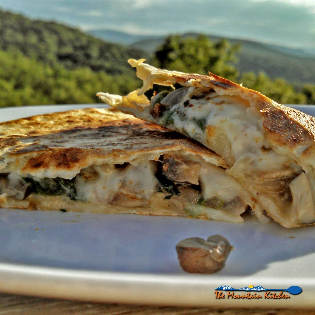 Spicy Pepper Jack Mushroom-Spinach Quesadillas are made with sauteed mushrooms, onions and spinach and gooey pepper jack cheese.