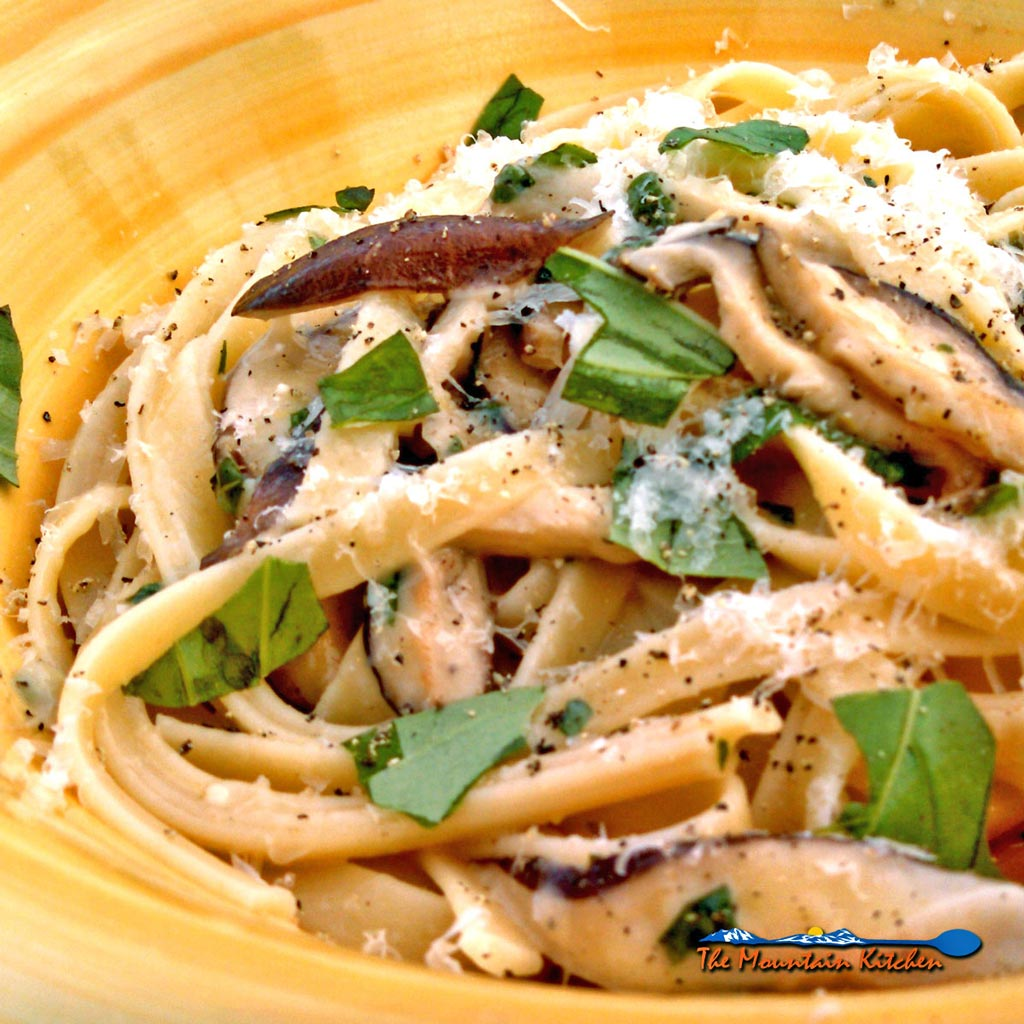 Zesty Shiitake Mushroom Pasta features shiitake mushrooms in a nest of fettuccine noodles flavored with garlic, parmesan cheese, lemon zest, and fresh basil.