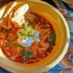 Inspired by Ina Garten, this Mexican chicken soup is made in the crock-pot. This soup is filled with chicken, vegetables, and Mexican flavors you'll love! | TheMountainKitchen.com