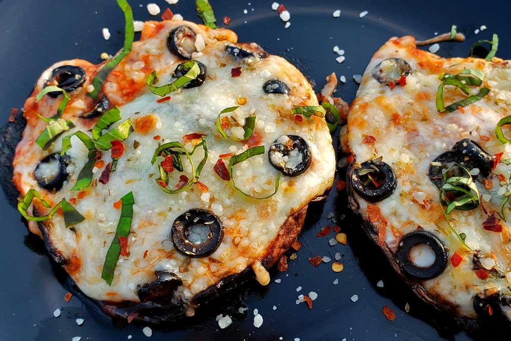 portobello mushroom cap pizzas on plate