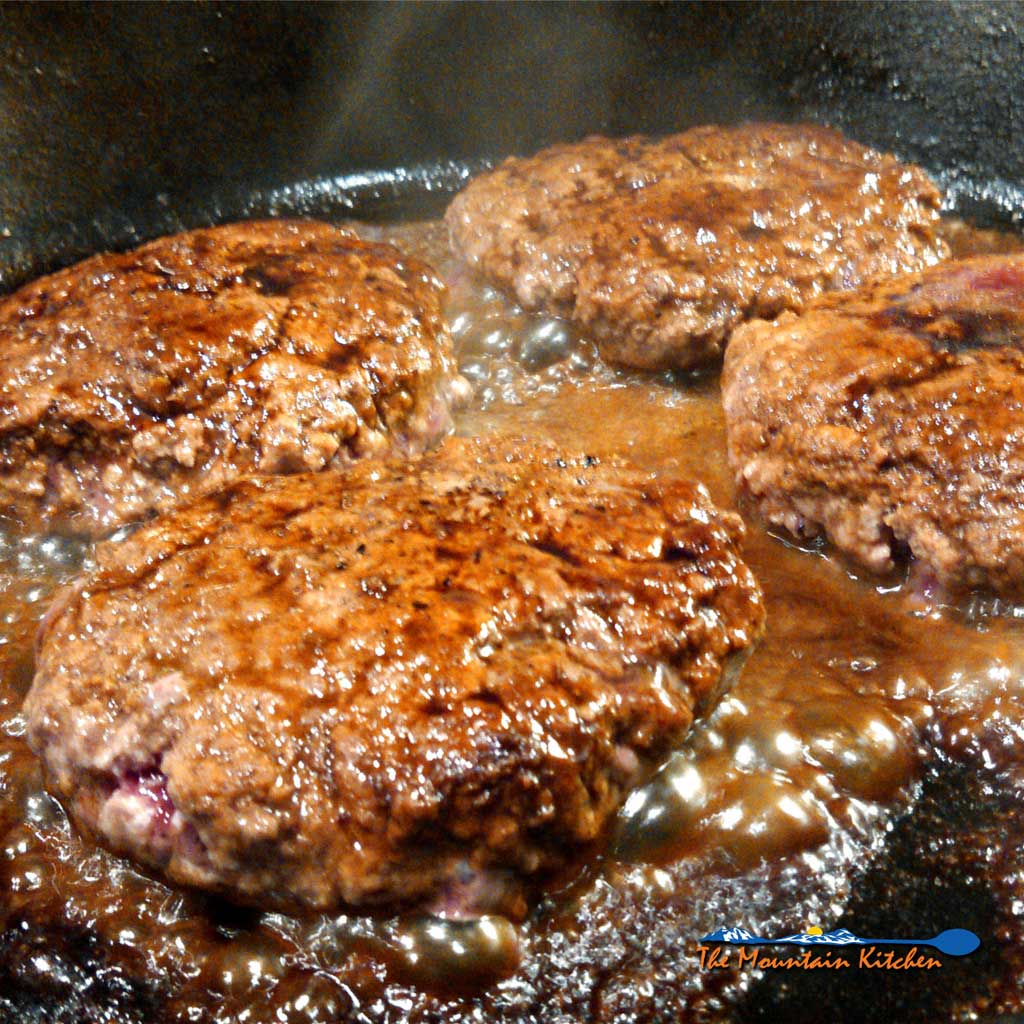 Sizzle burgers are fried ground beef patties seasoned with salt & pepper, in a pan with Worcestershire sauce and butter. Place them on a bun and enjoy! | TheMountainKitchen.com