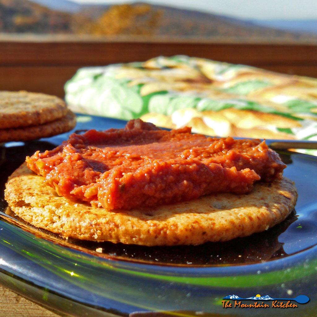 sun-dried tomato pesto on a cracker
