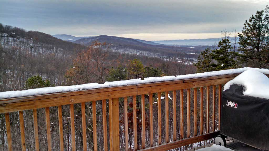 the view from our deck with snowy mountains