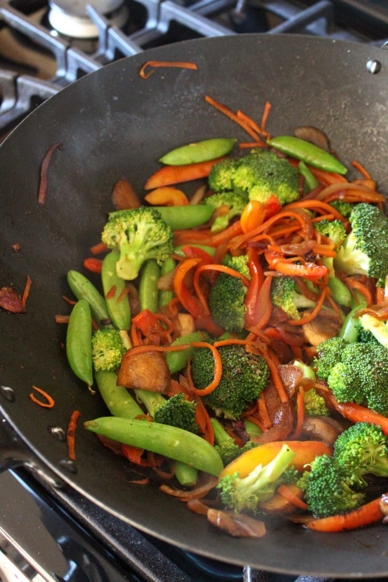 vegetables cooking in a wok