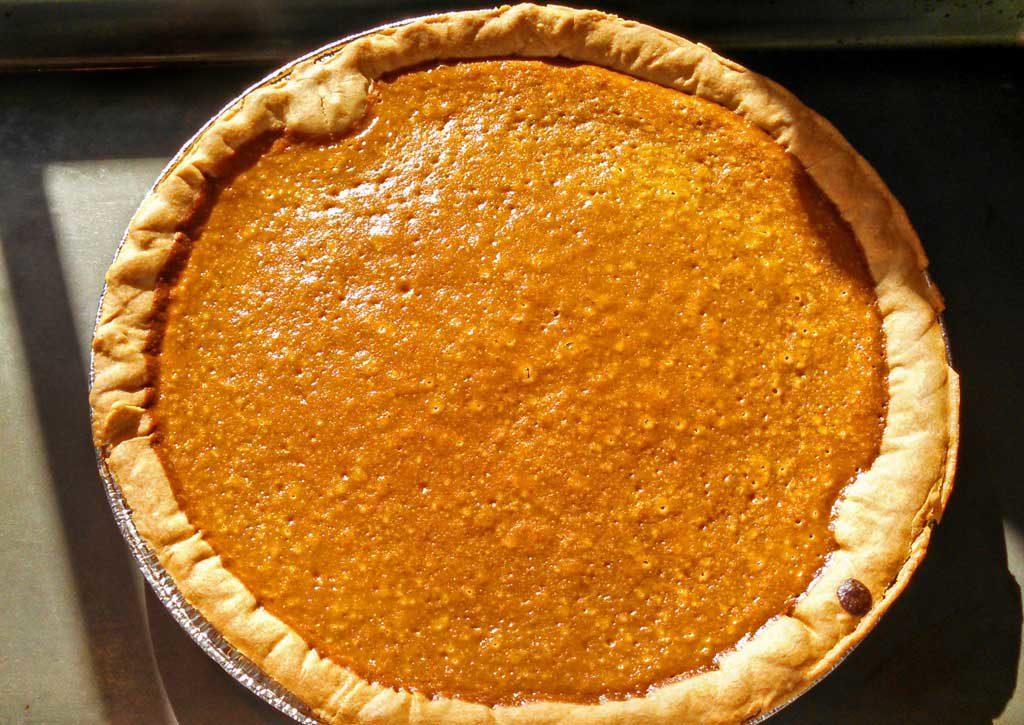 homemade pumpkin pie cooling