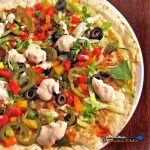 Mexican refried bean pizza is made with tortillas filled with refried beans and cheese, fried like a quesadilla, with toppings like a pizza. | TheMountainKitchen.com