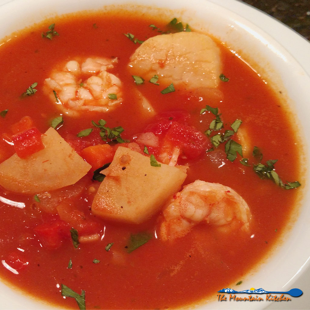 As a light summer dinner or a hearty winter meal, this healthy rich seafood soup has layers of flavors and could be made with a variety of fresh seafood.