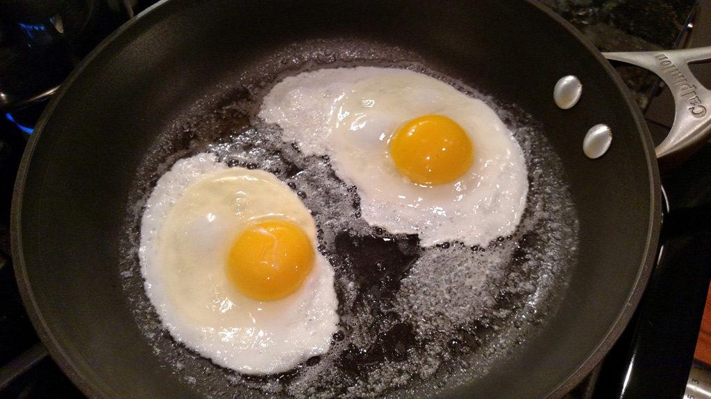 frying eggs in a pan