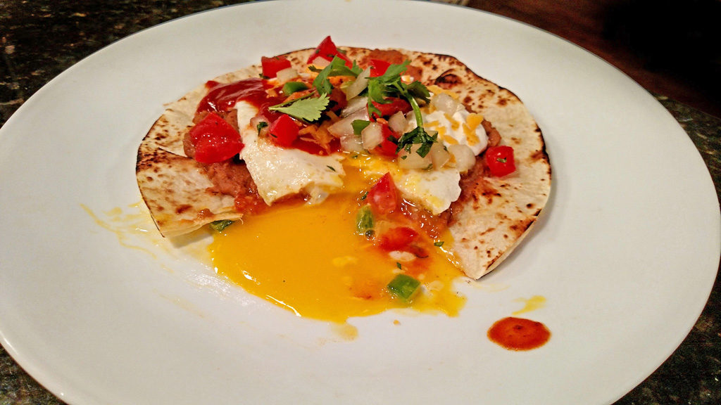 Huevos Rancheros on a plate ready to eat