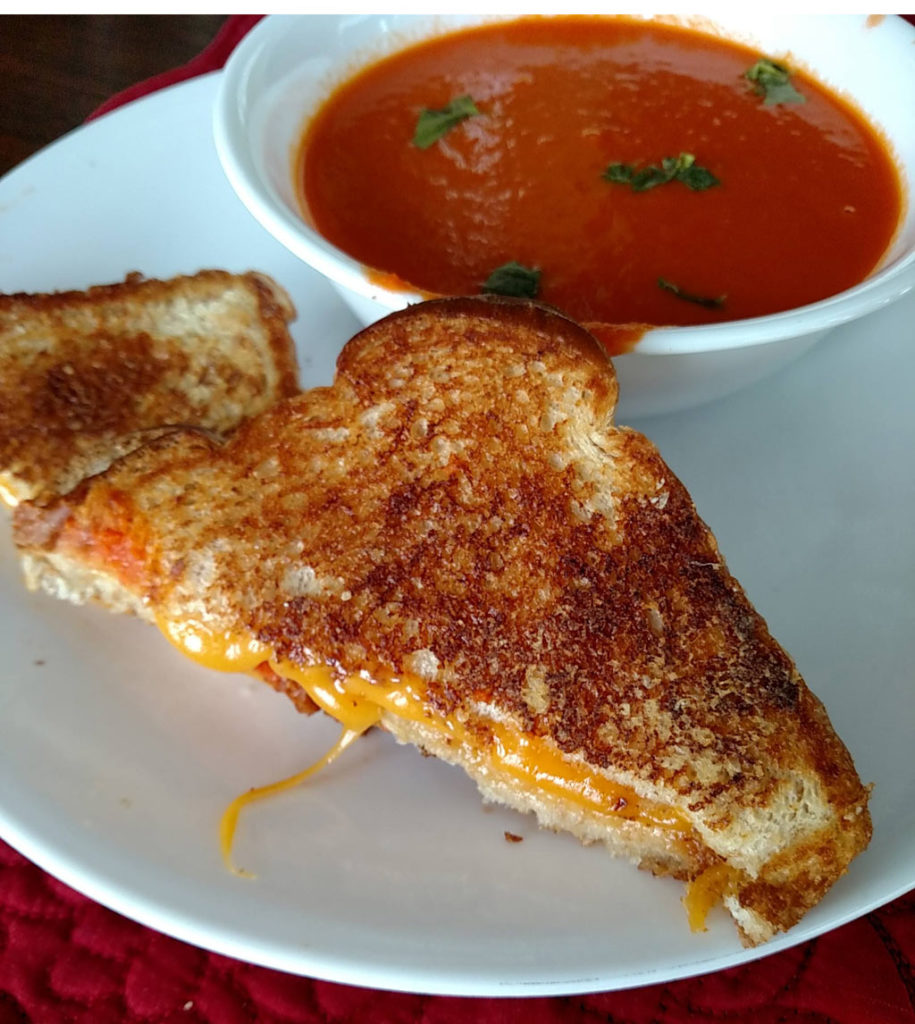 This Pioneer tomato soup is comfort food that is perfect paired with your favorite grilled cheese sandwich. Make a double batch and freeze for another day! | TheMountainKitchen.com