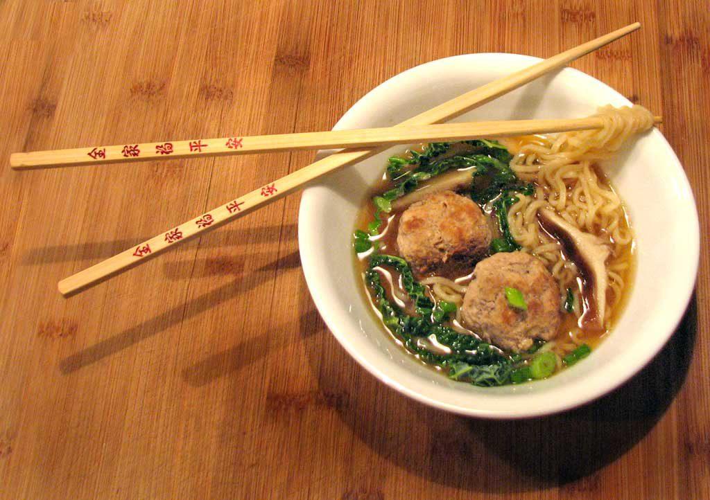 pork ramen noodle soup in bowl with chopsticks