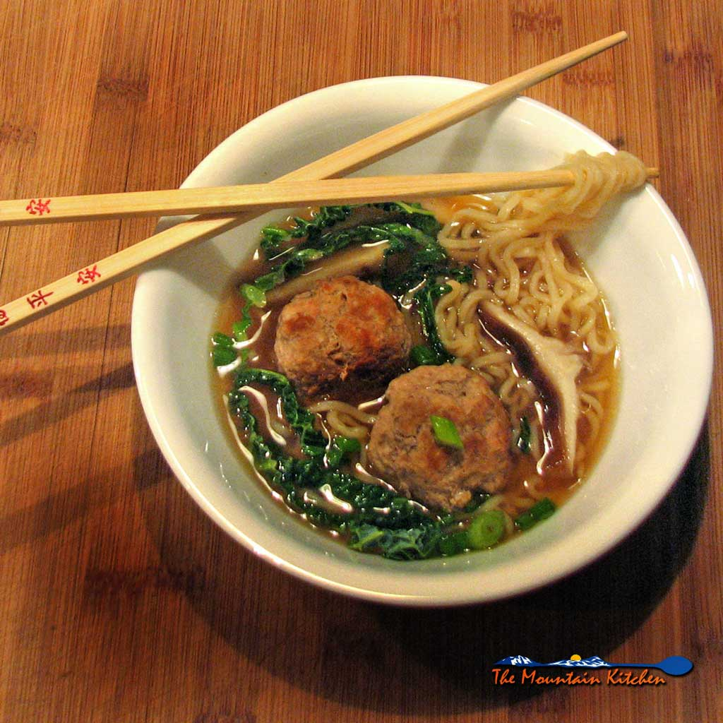 This Asian inspired pork ramen noodle soup has caramelized pork meatballs and ramen noodles in a rich broth flavored with soy sauce and warm ginger.
