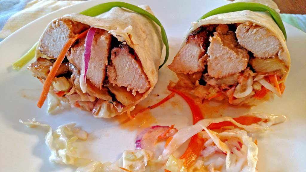 Grilled juicy chicken and pineapple slices with slaw and cashews rolled up in a sandwich wrap to make Asian Chicken Wraps. A great spring grilling recipe! | TheMountainKitchen.com