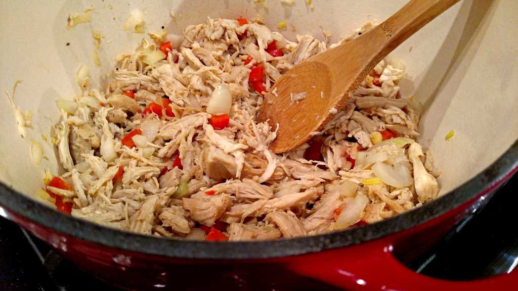 chicken and peppers in pot