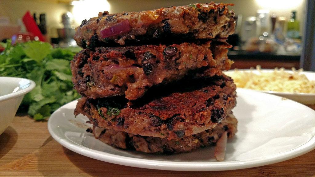 Pepper Jack Black Bean Burgers stacked in plate