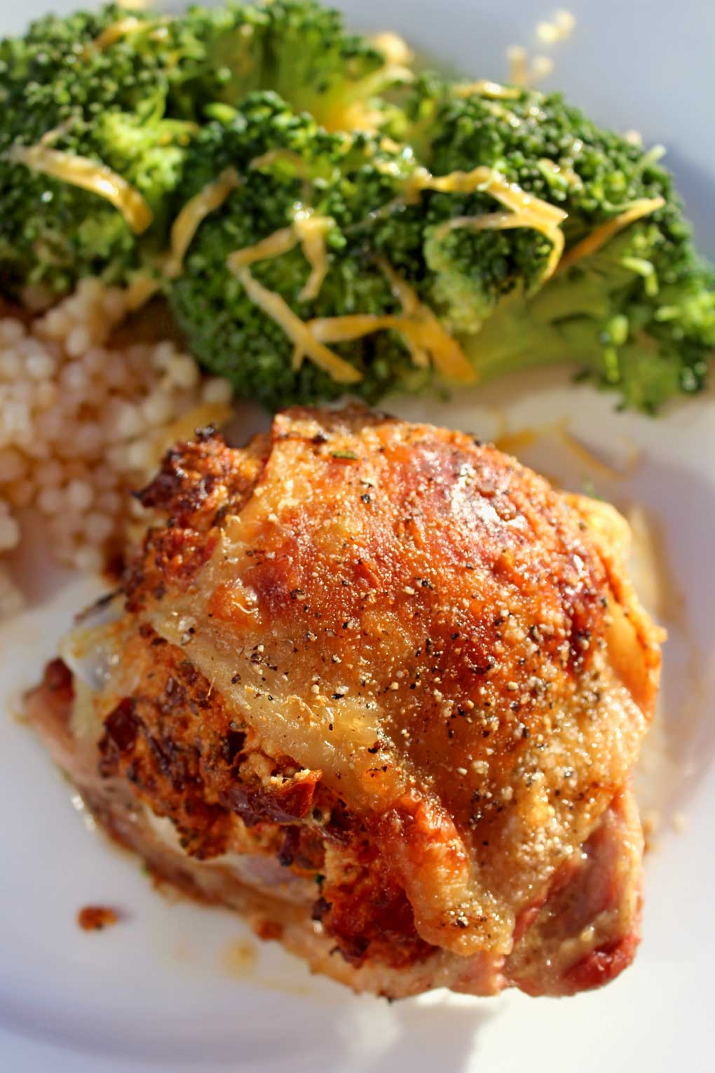 Sun-Dried Tomato Goat Cheese Stuffed Chicken: tender juicy chicken with tangy seasoned goat cheese and sun-dried tomatoes stuffed under crispy golden skin.