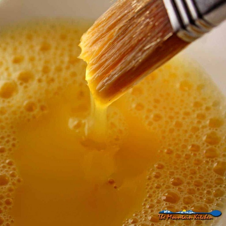 In the culinary arts, the term Egg Wash refers to a mixture of beaten eggs and some sort of liquid which is brushed pastry, before baking. | TheMountainKitchen.com