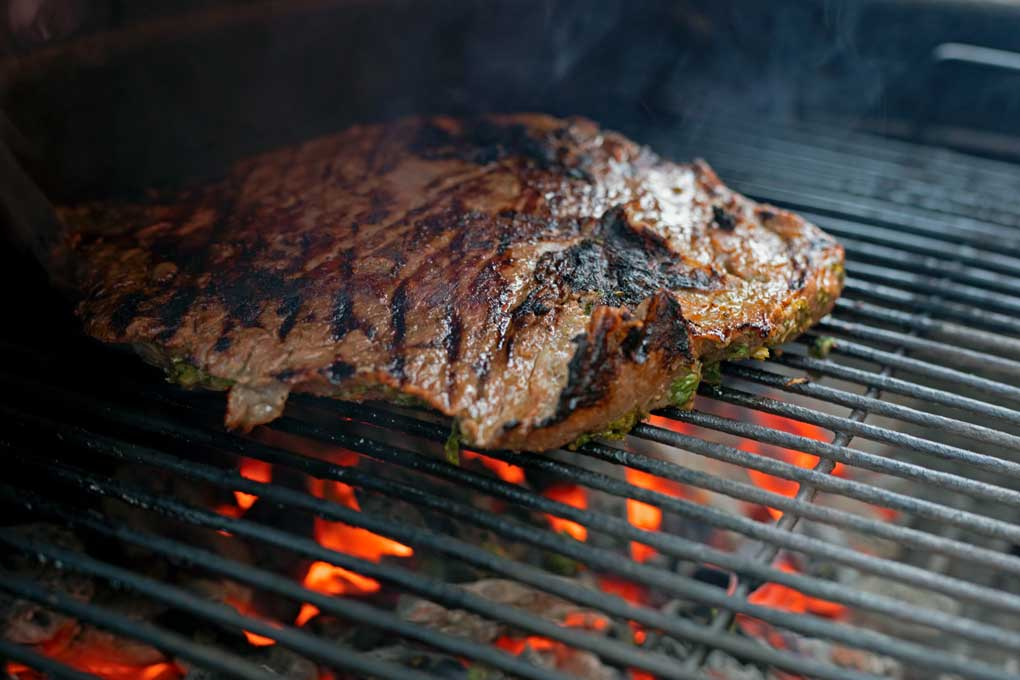 carne asada cooking on grill