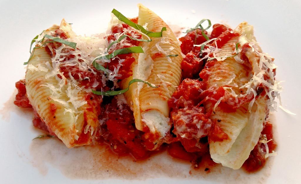 Using both homemade sauce and ricotta cheese, this Meatless Monday ricotta cheese stuffed shells recipe is pure comfort food. You'll forget it's meatless!   TheMeatlessMonday.com