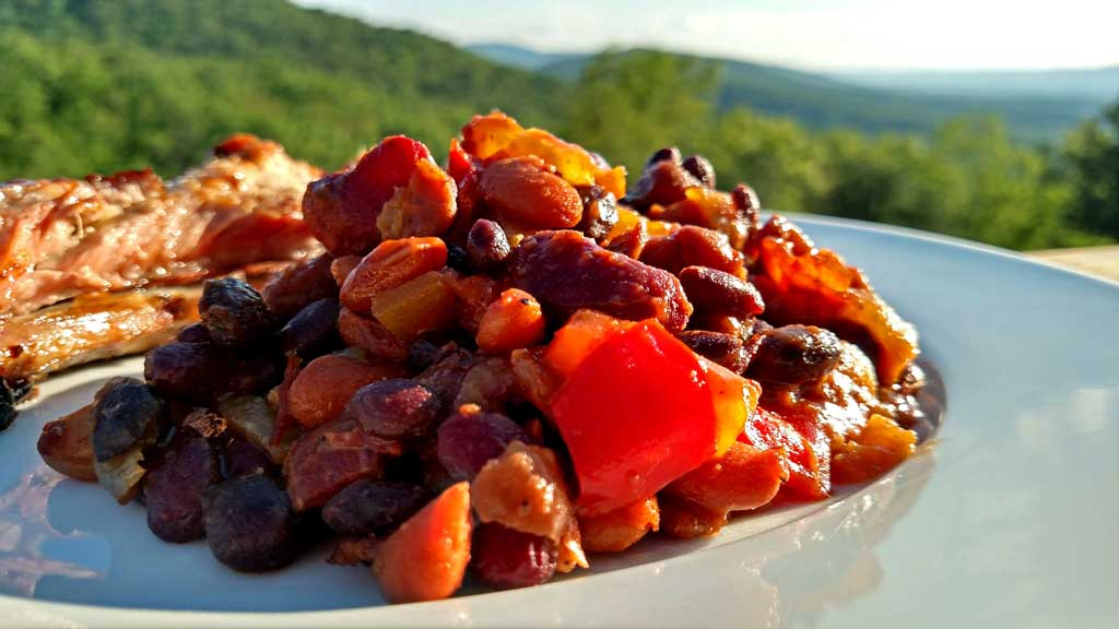 Smoky Pineapple Baked Beans with bacon and chipotle chile pepper, pineapple, red pepper, with hints of barbecue sauce and beer that round out the flavors. | TheMountainKitchen.com